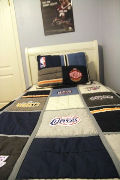 Redecorating your teenage boy's room? This sports themed room has ideas for bedding, wall hangings, functional desk space and a reading nook.